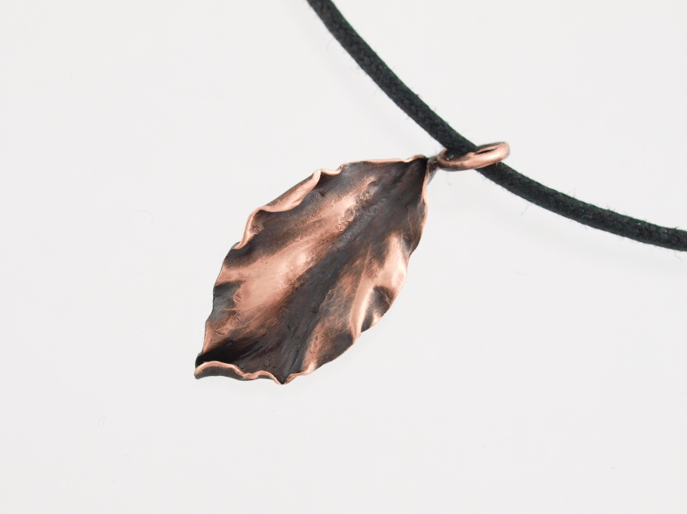 Copper leaf charm, image credited to knitsteel on flickr
