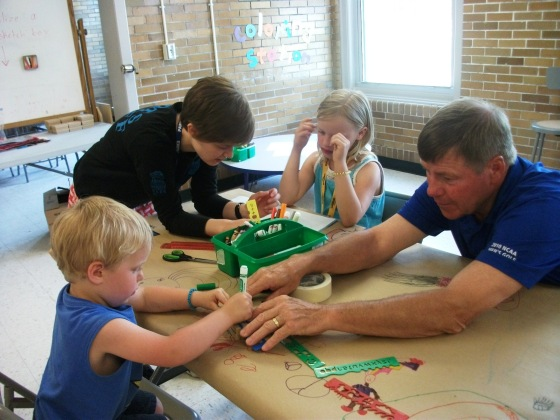 Family working together in Arts for All room