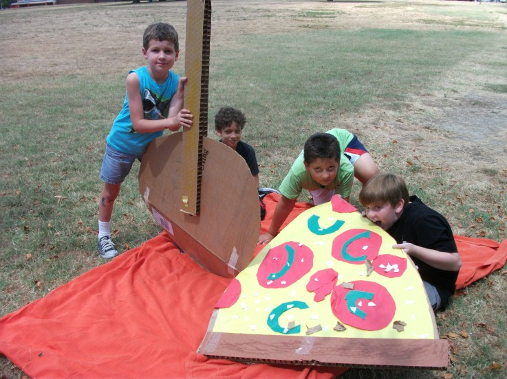 Campers eating their giant pizza