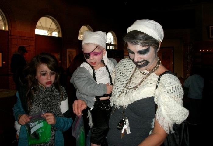 Visitors in creepy costumes