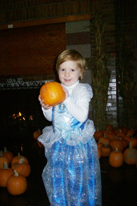 Girl showing off her pumpkin