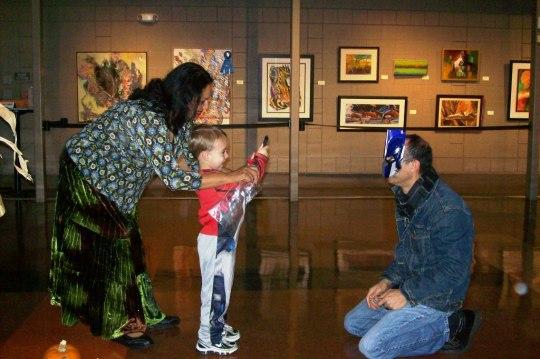 Boy taking picture of masked man